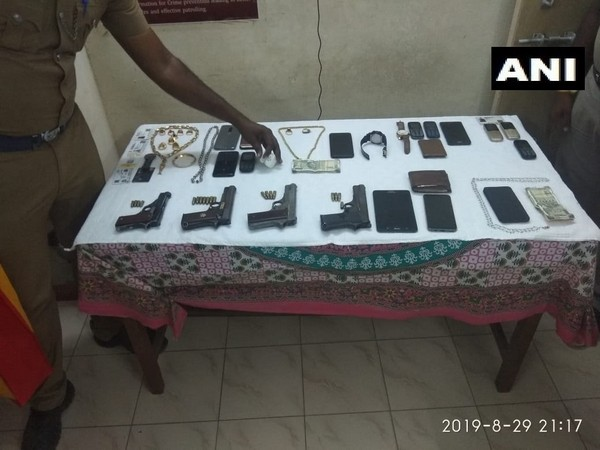 Pistols and other things seized from occupants of the car by police. Photo/ANI
