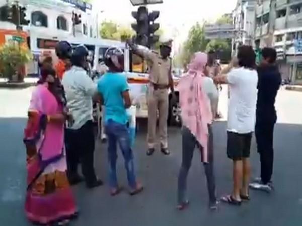 Nagpur police making curfew violators do squats in Nagpur on Tuesday.