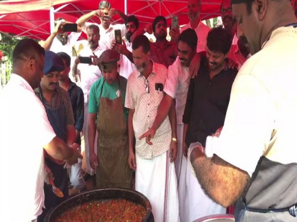 Members of Malappuram District Committee serving biryani to people in Kerala on Friday, which was prepared without onion. Photo/ANI