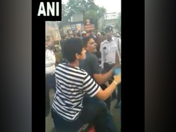 A woman and a man misbehaved&manhandled a traffic police cop on being stopped for not wearing helmet.