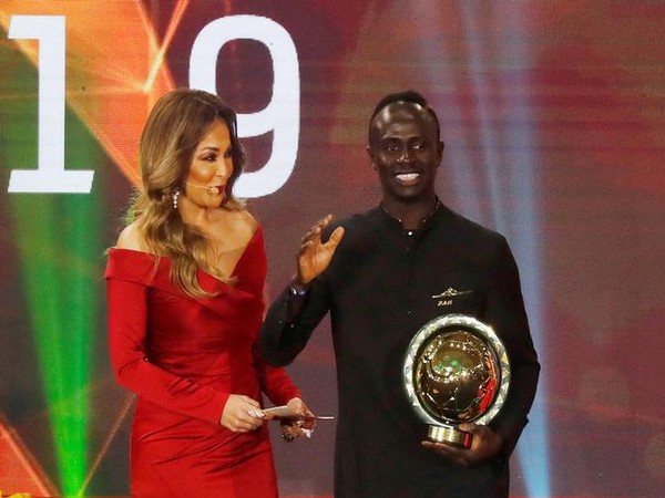 Sadio Mane with the African player of the year 2019 trophy at CAF Awards.