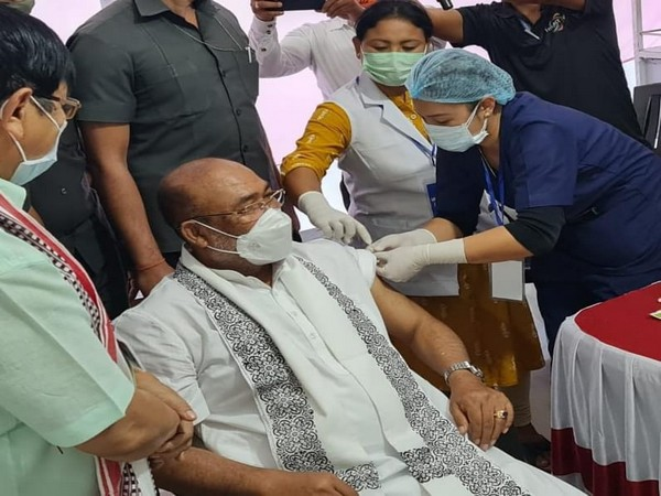 Manipur Chief Minister N Biren Singh receving his first dose of COVID-19 vaccine. (Photo/ANI)