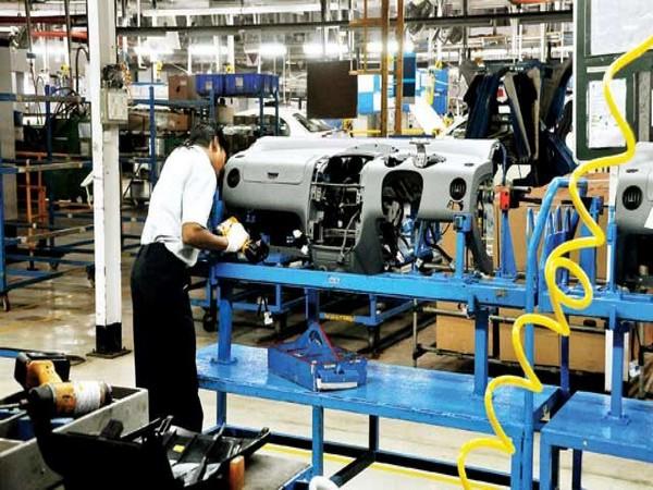 Softer upturn in sales underpins slower output growth
