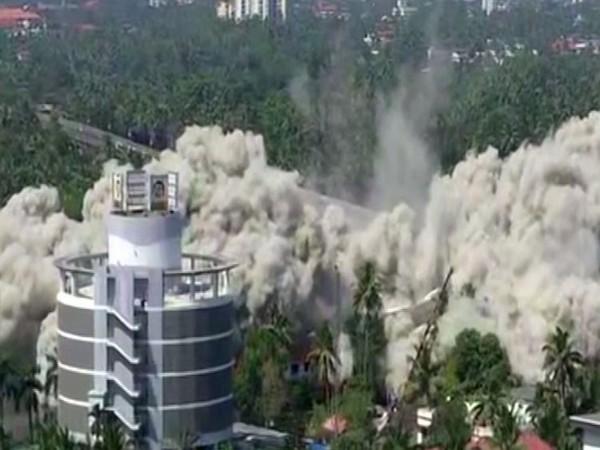 Illegal apartment complex in Maradu being destroyed in, Koch, Kerala.