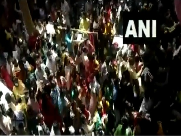Crowd of devotees flouting COVID-related guidelines at Shri Bankey Bihari Ji Temple in Vrindavan on Friday. (Photo/ANI)