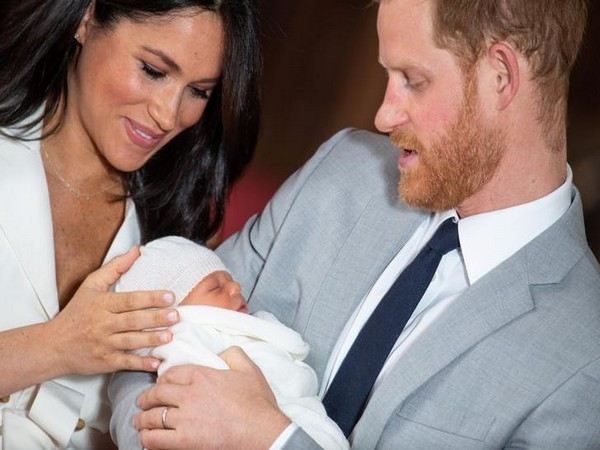 Britain's Prince Harry and Meghan, Duke and Duchess of Sussex, hold their baby son