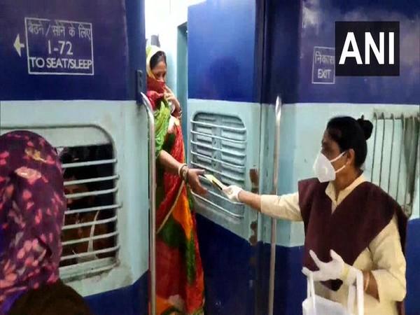 Employees of Indian Railways distributing sanitary pads. (Photo/ANI)