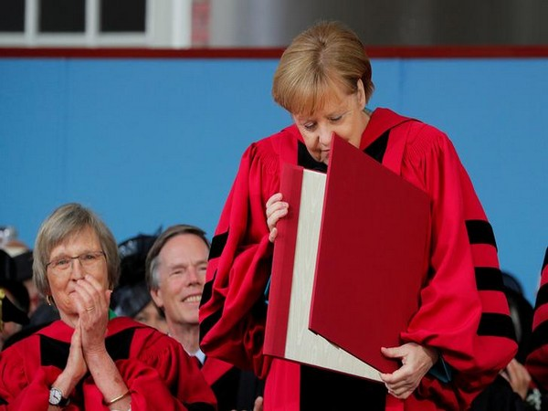 German Chancellor Angela Merkel looks at her honorary Doctor of Laws degree during the 368th Commencement Exercises at Harvard University on Thursday