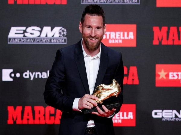 Barcelona's Lionel Messi poses with the Golden Shoe.