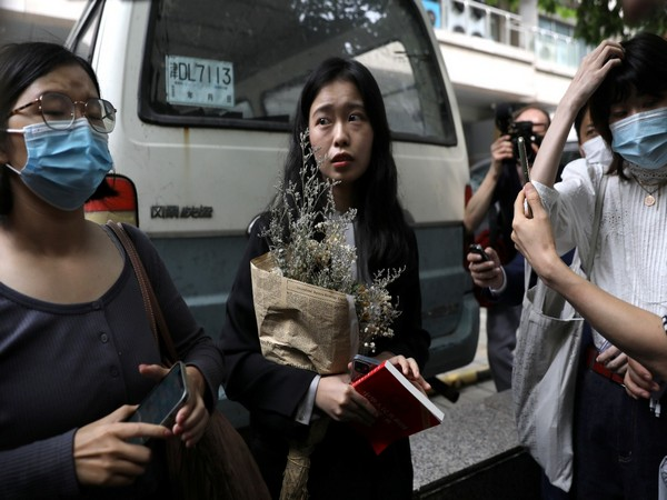 Zhou Xiaoxuan, also known by her online name Xianzi, speaks to supporters as she arrives at a court for a sexual harassment case involving a Chinese state TV host