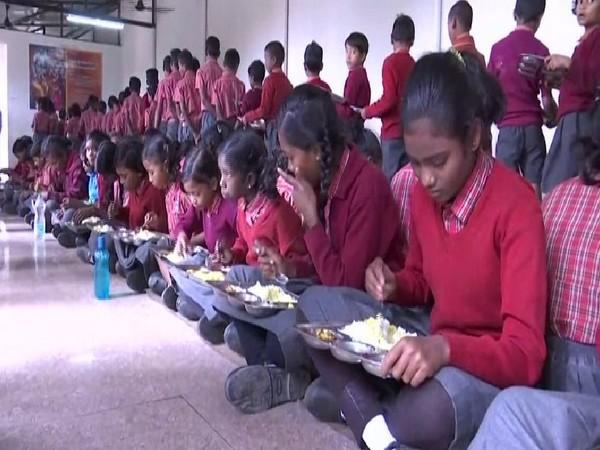 Children eating the mid-day meal in Adani Vidya Mandir in Chhattisgarh.