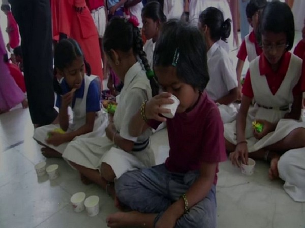 Children were fed milk as part of awareness campaign ahead of Nag Panchami by Basava Kendra in Shivamogga on Saturday. Photo/ANI