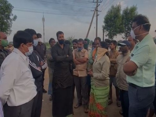 Andhra Pradesh Irrigation Minister P Anil Kumar (in black) Saturday visited flood-affected areas in Nellore.