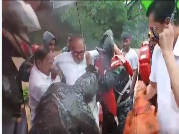 Former Union Minister B Janardhana Poojary being rescued by the district administration officials from his house in flood-affect Bantwal on Saturday. Photo/ANI