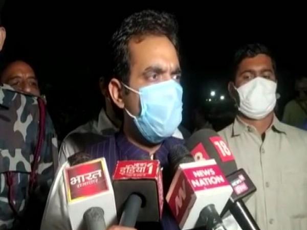Noida MLA Pankaj Singh speaking to reporters on Tuesday.