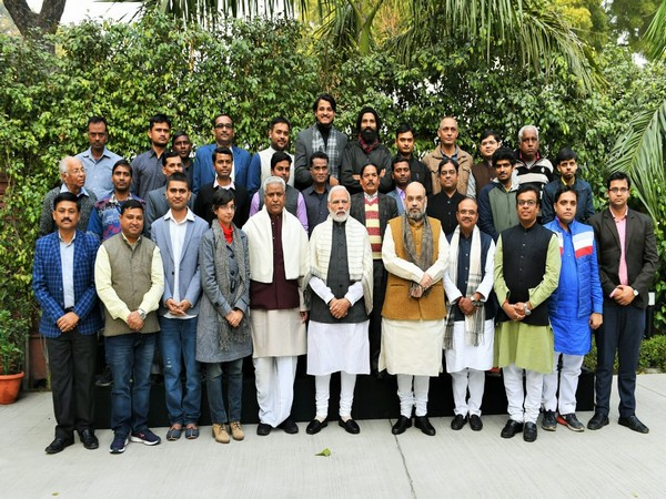 Photo from last year's Prime Minister Modi with BJP staff.