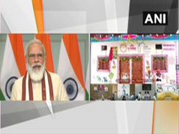 Prime Minister Narendra Modi speaking at the inauguration of houses built under PM Awas Yojana-Gramin in MP on Saturday. Photo/ANI
