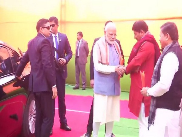 Prime Minister Narendra Modi with Delhi BJP chief Manoj Tiwari at Ramlila Maidan on Sunday. photo.ANI