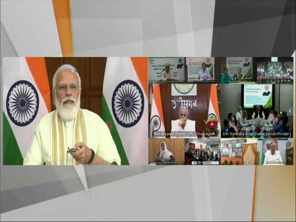 Prime Minister Narendra Modi dedicating to the nation 35 crop varieties with special traits. (Photo/ ANI)