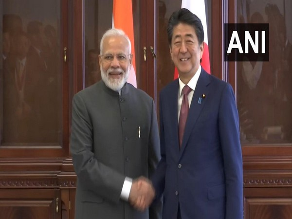 PM Narendra Modi with his Japanese counterpart Shinzo Abe in Vladivostok on Thursday.
