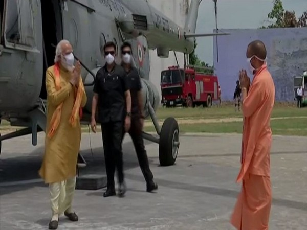 Prime Minister Narendra Modi received by Uttar pradesh Chief minister Yogi Adityanath on his arival in Ayodhya on Wednesday. (Photo/ANI)