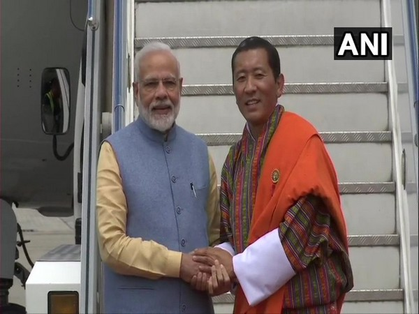 Prime Minister Narendra Modi received by his Bhutanese counterpart Dr Lotay Tshering at the Paro International Airport on Saturday.