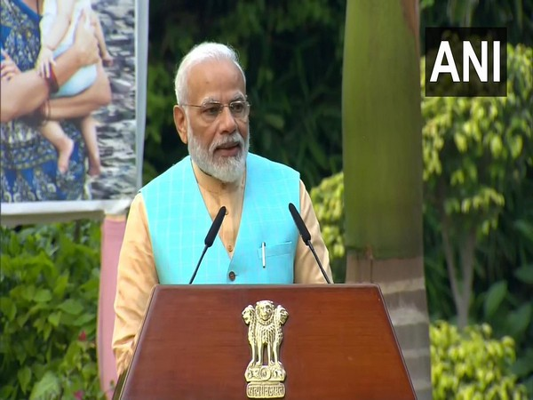 Prime Minister Narendra Modi addressing members of unauthorised colonies in New Delhi on Friday. Photo/ANI