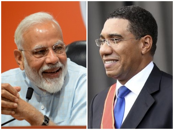 Prime Minister Narendra Modi  with his Jamaican counterpart Andrew Michael Holness (right)