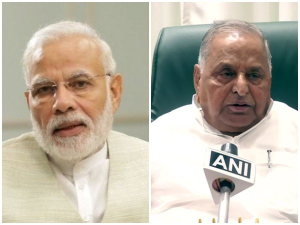 Prime Minister Narendra Modi and Samajwadi Party (SP) patriarch Mulayam Singh Yadav (right)