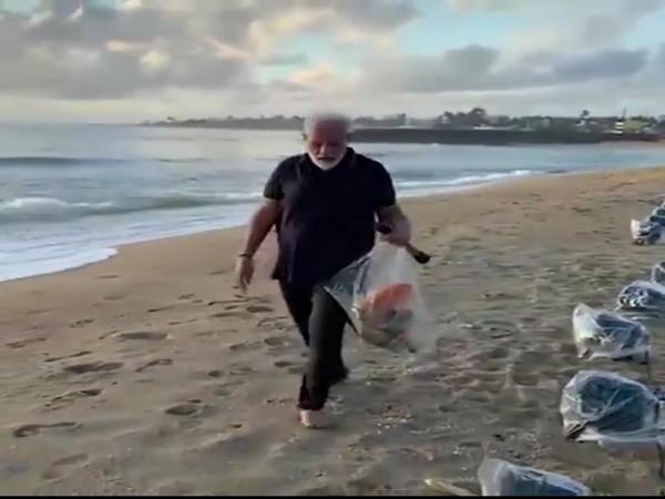PM Narendra Modi plogging at a beach in Mamallapuram on Saturday. Photo/Twitter