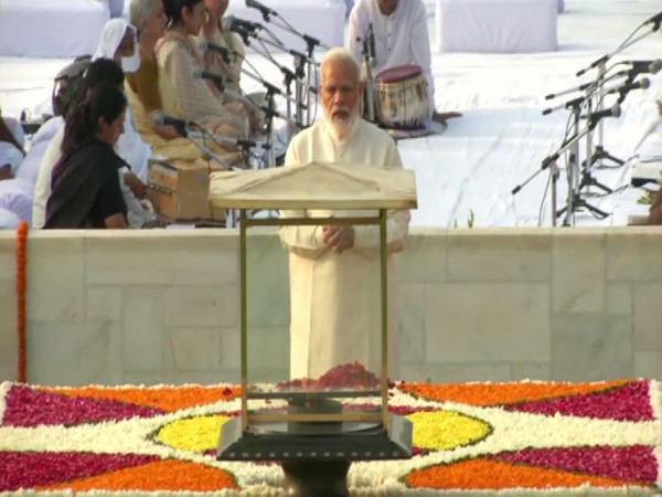 Prime Minister Narendra Modi pays tribute to Mahatma Gandhi at Raj Ghat on Wednesday. Photo/ANI