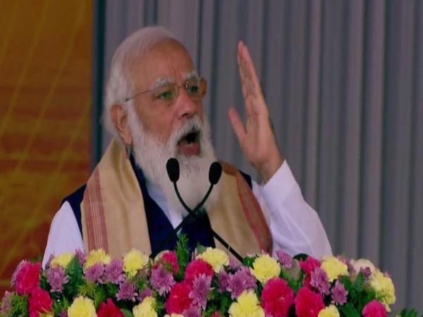 Prime Minister Narendra Modi addressing a public meeting in Assam's Sivasagar on Saturday.