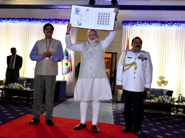 PM Modi releasing commemorative stamp in honour of Marshall of IAF Arjan Singh. (Photo/Narendra Modi twitter account)