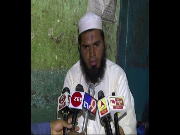 Mohammad Yusuf talking to media persons.