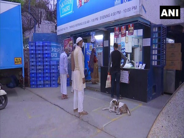 Social distancing being practised by buyers at a Mother Dairy store in Delhi's Patparganj on Friday. Photo/ANI