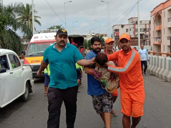 Mukesh Singh helped the woman who was trapped in a water-logged area.
