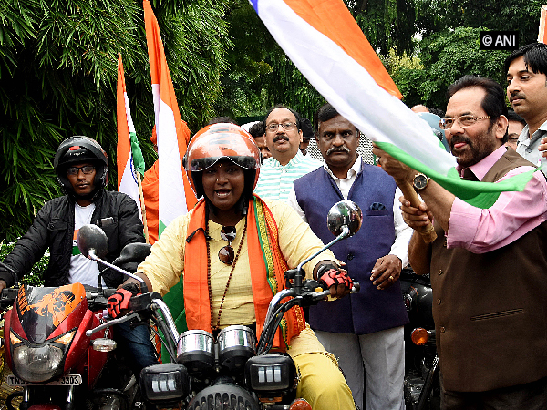 Union Minister Mukhtar Abbas Naqvi flagging off the bike rally to Kashmir in New Delhi on Sunday. Photo/ANI