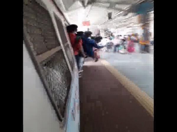 Minor boys performing stunts on Mumbai local train