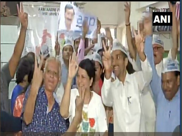 Aam Aadmi Party workers in Mumbai's Andheri celebrate the party's performance