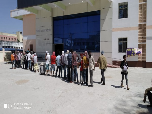 People standing in queue outside a hospital in Muzzafarpur [Photo/ANI]