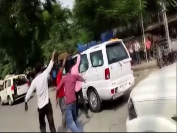 Protesters throw ink at Bihar Chief Minister Nitish Kumar's vehicle. Photo/ANI
