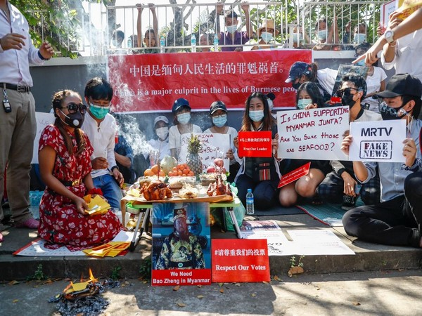 Myanmar civilians protesting against China on Friday. (ANI)