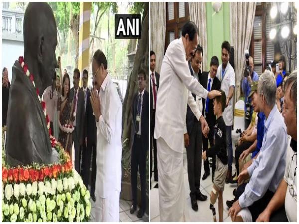 Vice President M Venkaiah Naidu paid tribute to Mahatma Gandhi and visited Jaipur Foot Artificial Limb Fitment Camp in Hanoi, Vietnam, on Saturday