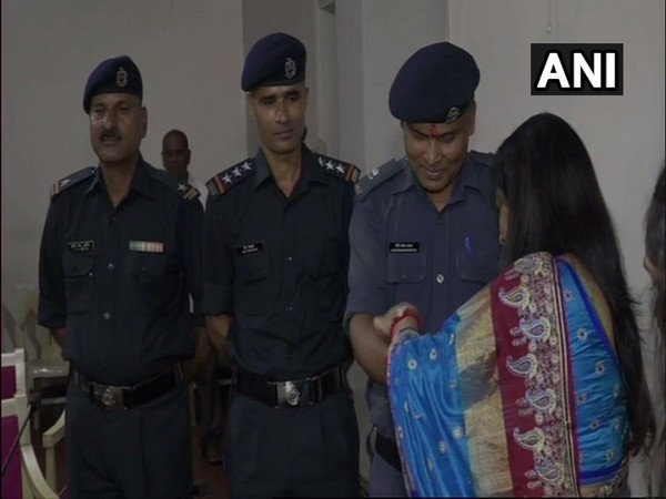 Vadodara District Collector Shalini Agarwal tied rakhi on the wrists of NDRF personnel.
