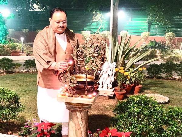 BJP president JP Nadda lighting a lamp at his residence in New Delhi on Saturday. Photo/ANI