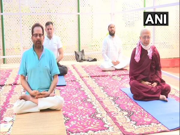 Union Minister Mukhtar Abbas Naqvi performing Yoga on Sunday. [Photo/ANI]
