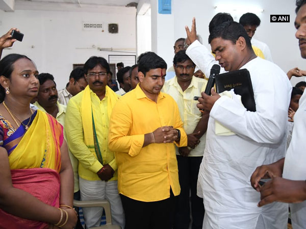 Andhra Pradesh IT Minister Nara Lokesh offering prayer at a church in Andhra Pradesh on Sunday. Photo/ANI