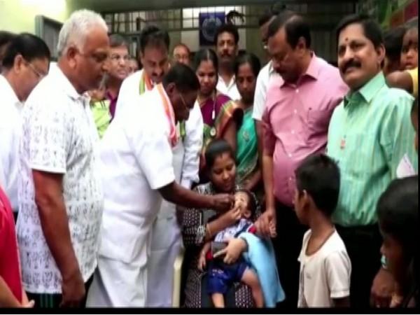Puducherry Chief Minister V Narayanasamy giving polio drops to a child on Sunday. Photo/ANI