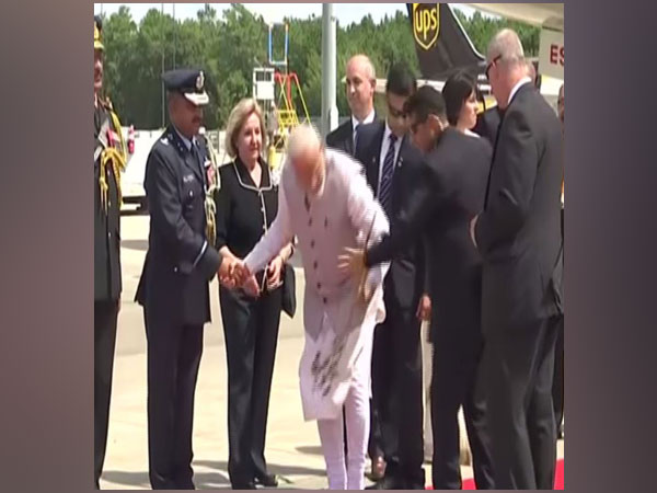 Prime Minister Narendra Modi left netizens impressed when he picked up a flower from the ground. Photo/ANI