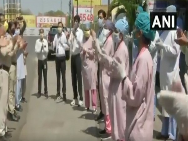 Police officers and doctors applaud each other for their services amid COVID-19 lockdown in Bhopal. Photo/ ANI